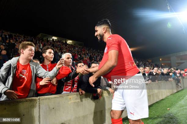 Umut Bozok of Nimes celebrates victory with fans during the Ligue 2 match between Nimes Olympique and Brest on October 20 2017 in Nimes France