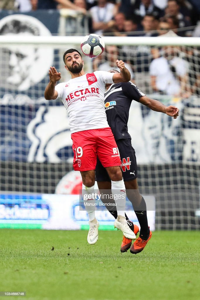 12 EME JOURNÉE DE LIGUE 1 CONFORAMA : DIJON FCO  / NÎMES OLYMPIQUE   Umut-bozok-of-nimes-during-the-french-ligue-1-match-between-bordeaux-picture-id1034688748
