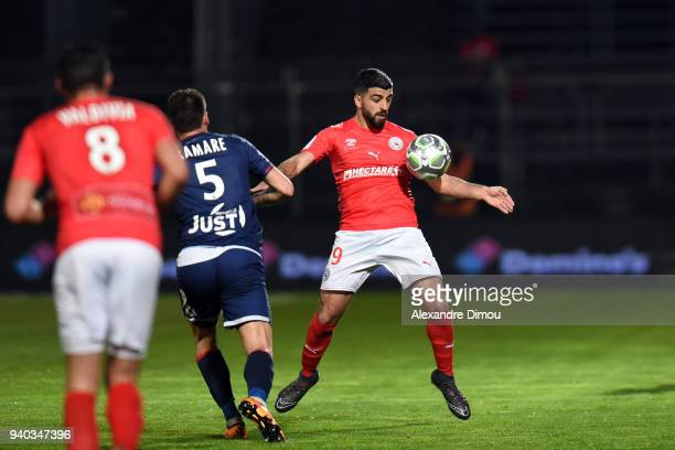 Umut Bozok of Nimes during the Ligue 2 match between Nimes and Valenciennes on March 30 2018 in Nimes France