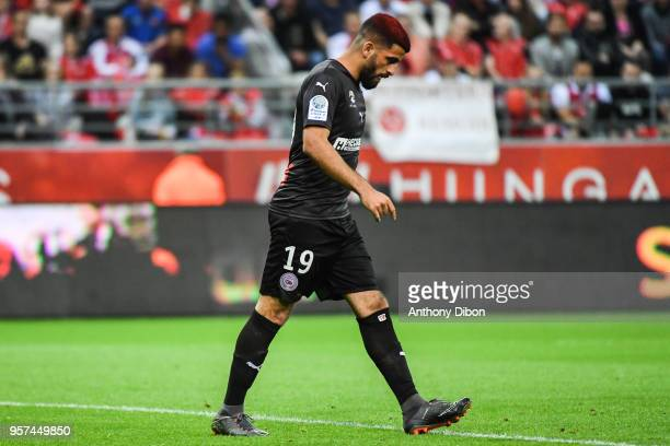 Umut Bozok of Nimes looks dejected during the French Ligue 2 match between Reims and Nimes at Stade Auguste Delaune on May 11 2018 in Reims France