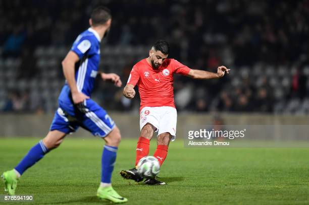 Umut Bozok of Nimes scores his third Goal during the Ligue 2 match between Nimes and Bourg en Bresse at Stade des Costieres on November 24 2017 in...