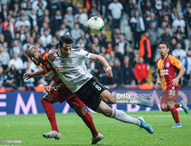 Umut Nayir of Besiktas in action against Marcao of Galatasaray during the Turkish Super Lig week 9 soccer match between Besiktas and Galatasaray at...