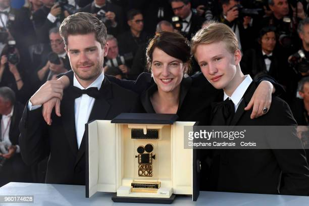 Un Certain Regard Best Performance winner Victor Polster for his role in 'Girl' poses with the Director Lukas Dhont and Camera d'Or jury head Ursula...