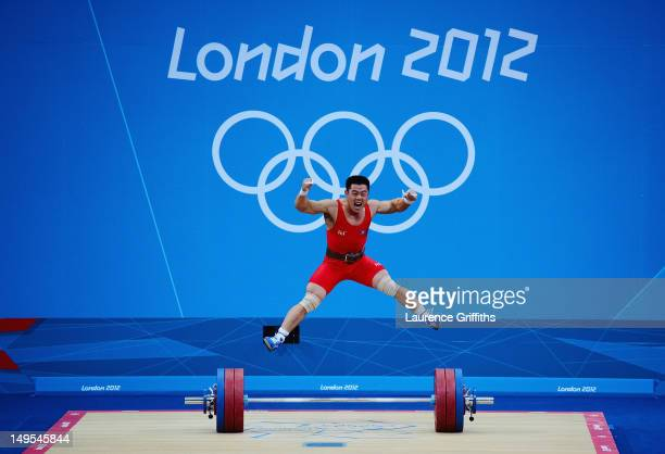 Un Guk Kim of DPR Korea celebrates making a world record while competing in the Men's 62kg Weightlifting on Day 3 of the London 2012 Olympic Games at...