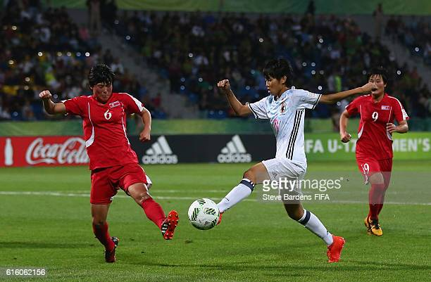 Un Gyong Pyon of Korea DPR blocks the shot of Riko Ueki of Japan during the FIFA U17 Women's World Cup Jordan 2016 Final match between Korea DPR and...