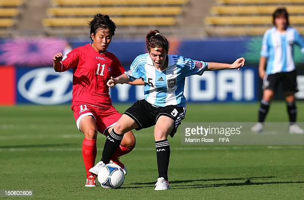 Un Hwa Kim of Korea DPR and Camila Gomez Ares of Argentina battle for the ball during the FIFA U20 Women's World Cup 2012 group C match between Korea...