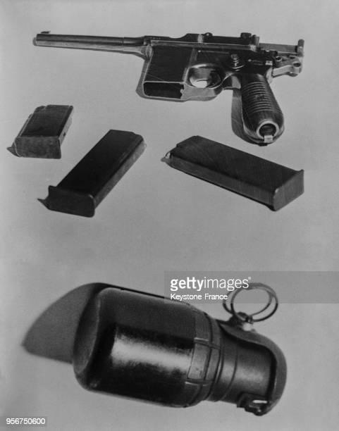 Un pistolet automatique Mauser avec ses chargeurs et une grenade à main trouvés sur Kalemen l'assassin du roi Alexandre 1er de Yougoslvaie et Lousi...