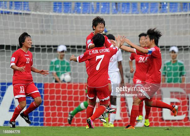 Un Sim Ri of Korea DPR celebrates scoring a goal with her team mates during the FIFA U17 Women's World Cup 2012 QuarterFinal match between Korea DPR...