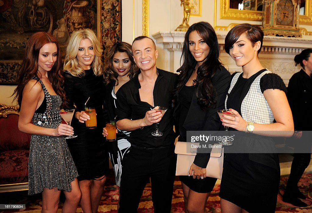 Una Healy, Mollie King, Vanessa White, Julien Macdonald, Rochelle Wiseman and Frankie Sandford pose backstage at the Julien Macdonald show during London Fashion Week Fall/Winter 2013/14 at Goldsmiths' Hall on February 16, 2013 in London, England.