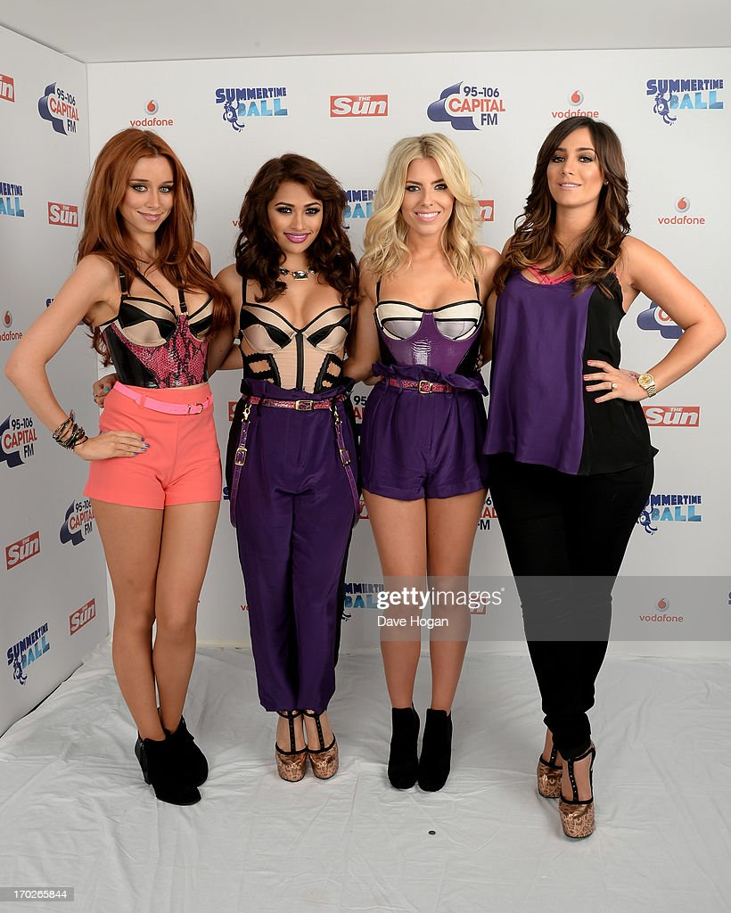 Una Healy, Vanessa White, Molly King and Frankie Sandford of The Saturdays pose in a backstage studio during the Capital Summertime Ball at Wembley Stadium on June 9, 2013 in London, England.