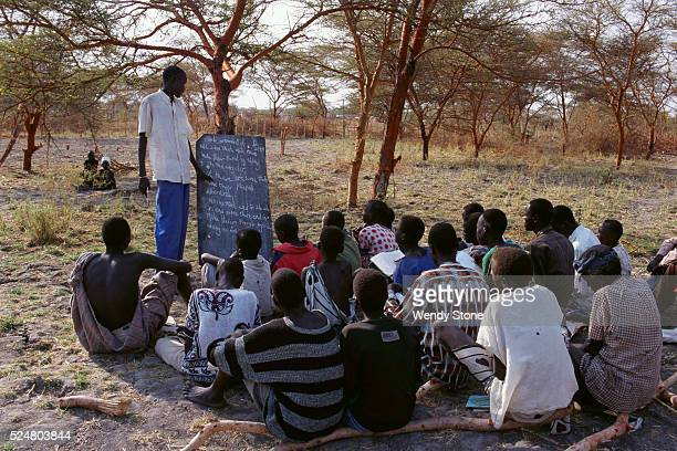 Unable to send children to school buildings that had been bombed the Nuer held classes under trees and in open outdoor areas The Nuer people are a...