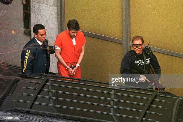 Unabomber suspect Theodore Kaczynski is escorted by armed US Marshalls outside the Federal Courthouse 08 January in Sacramento CA Kaczynski's trial...