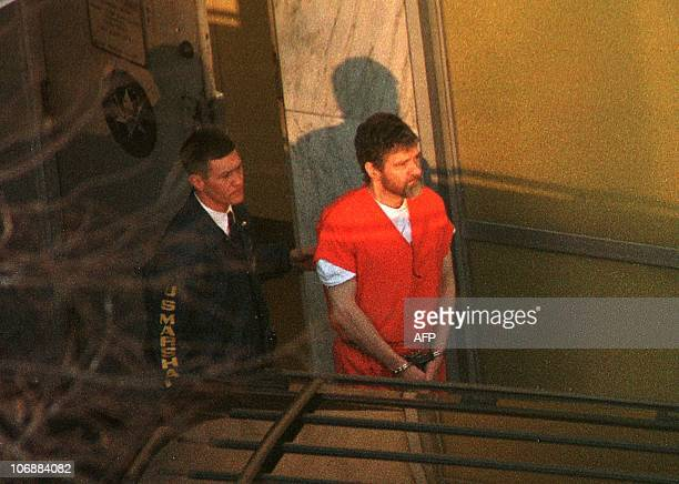 Unabomber suspect Theodore Kaczynski is lead out the Federal Courthouse by a US Marshal after a hearing to determine his competency 20 January in...