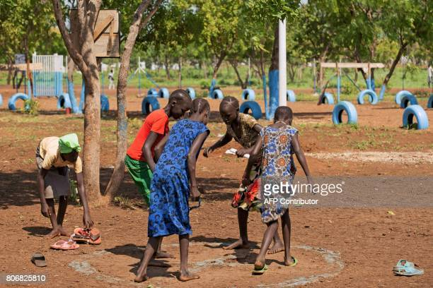 Unaccompanied children who travelled alone from South Sudan to the Ethiopian border play at the children friendly space of Plan International...