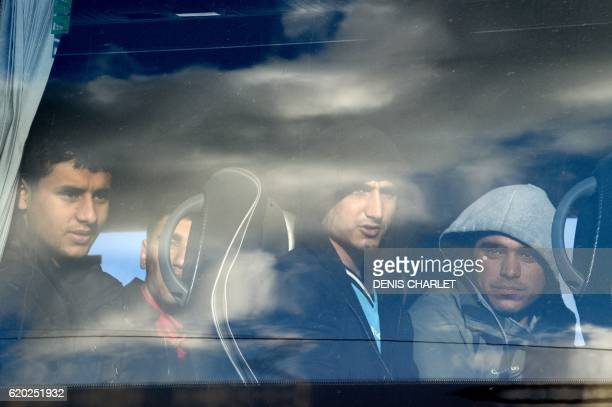 TOPSHOT Unaccompanied migrant minors from the demolished 'Jungle' migrant camp in Calais sit in a bus as they wait to travel to reception centres...