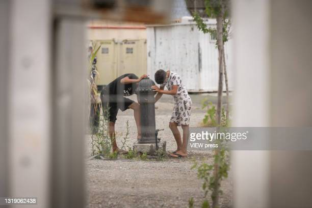 Unaccompanied minors are seen inside the Pinier shelter on May 20, 2021 in Ceuta, Spain. The Pinier shelter has been enabled as a reception center...