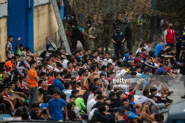 Unaccompanied minors who have already crossed the border between Morocco and Ceuta, wait in a juvenile center for a COVID-19 PCR test on May 19, 2021...