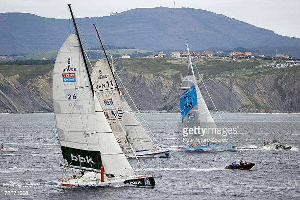 Unai Basurko de Miguel of Spain skipper of the Open 60 yacht Pakea leads Saga Insurance at the start of leg 1 of the Velux 5 Oceans race on October...