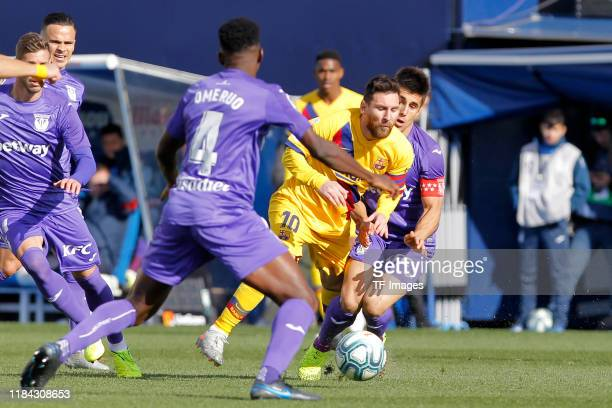 Unai Bustinza of CD Leganes and Lionel Messi of FC Barcelona battle for the ball during the Liga match between CD Leganes and FC Barcelona at Estadio...