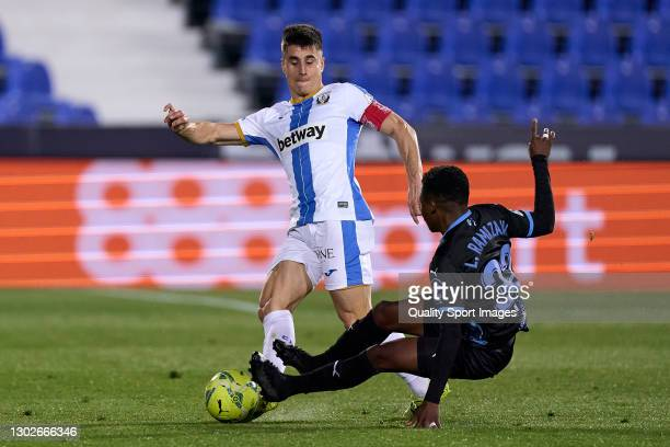 Unai Bustinza of CD Leganes is tackled by Largie Ramazani of UD Almeria during the La Liga Smartbank match between CD Leganes and UD Almeria at...