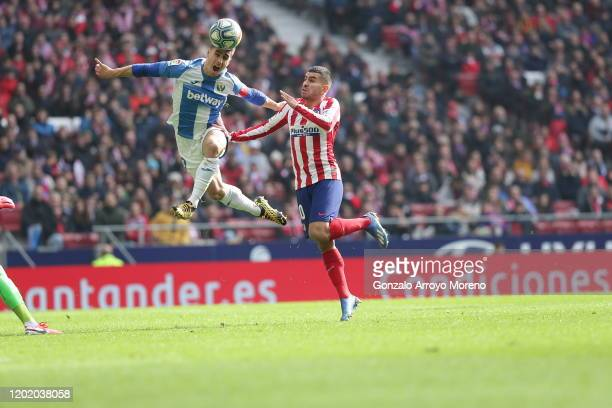 Unai Bustinza of Leganes and Angel Correa of Atletico Madrid battle for the ball during the Liga match between Club Atletico de Madrid and CD Leganes...