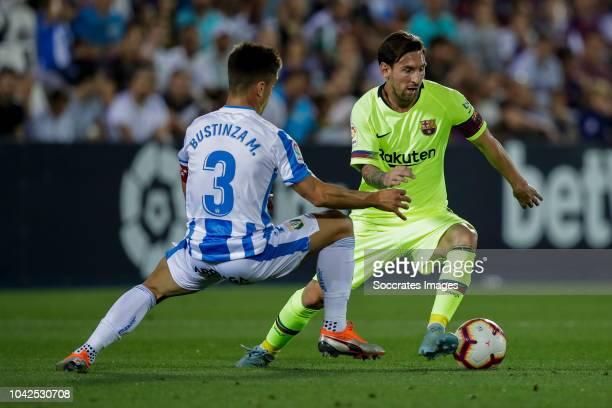 Unai Bustinza of Leganes Lionel Messi of FC Barcelona during the La Liga Santander match between Leganes v FC Barcelona at the Estadio Municipal de...