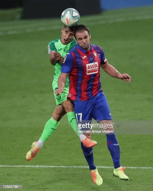 Unai Bustinza wins the header before Kike Garcia of SD Eibar during the Liga match between SD Eibar SAD and CD Leganes at Ipurua Municipal Stadium on...