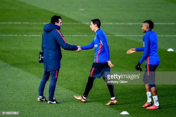 Unai Emery coach of PSG shakes hand with Angel Di Maria and Christopher Nkunku of PSG during training session of Paris Saint Germain PSG at Camp des...