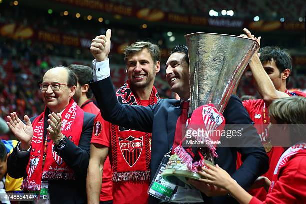 Unai Emery coach of Sevilla celebrates victory with Sevilla President Jose Castro and the trophy after the UEFA Europa League Final match between FC...