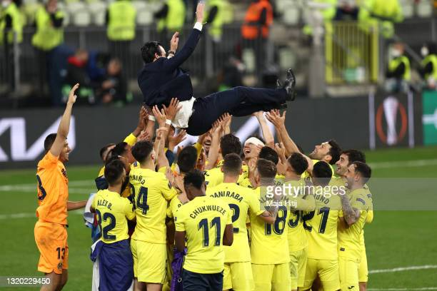 Unai Emery, Head Coach of Villarreal CF is thrown into the air as their side celebrate winning the UEFA Europa League Final between Villarreal CF and...