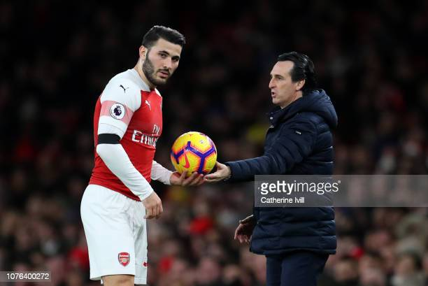 Unai Emery manager / head coach of Arsenal hands the ball to Sead Kolasinac of Arsenal during the Premier League match between Arsenal FC and Fulham...