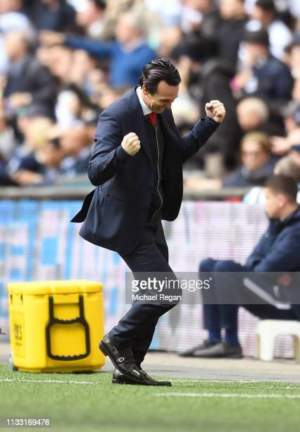 Unai Emery Manager of Arsenal celebrates after Aaron Ramsey of Arsenal scores his team's first goal during the Premier League match between Tottenham...