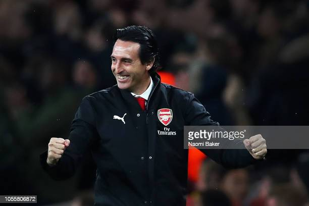 Unai Emery Manager of Arsenal celebrates after his team score their sides first goal during the Carabao Cup Fourth Round match between Arsenal and...