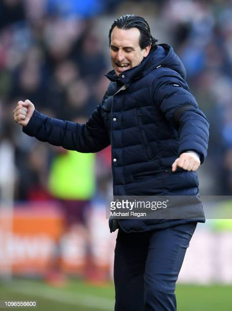 Unai Emery Manager of Arsenal celebrates after his team's second goal during the Premier League match between Huddersfield Town and Arsenal FC at...