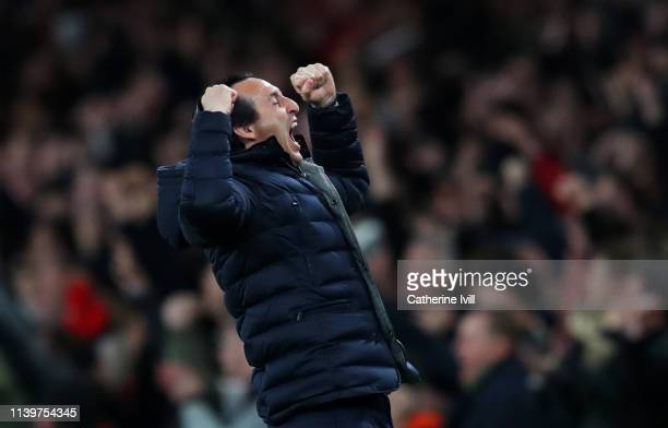 Unai Emery Manager of Arsenal celebrates as Aaron Ramsey of Arsenal scores his team's first goal during the Premier League match between Arsenal FC...