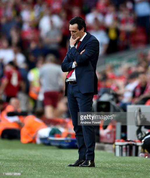 Unai Emery manager of Arsenal dejected during the Premier League match between Liverpool FC and Arsenal FC at Anfield on August 24 2019 in Liverpool...
