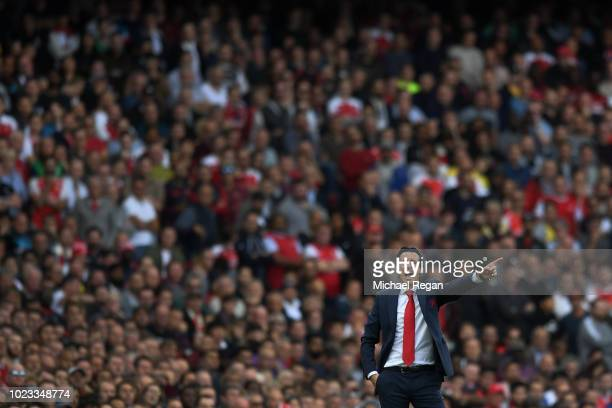 Unai Emery manager of Arsenal gestures during the Premier League match between Arsenal FC and West Ham United at Emirates Stadium on August 25 2018...