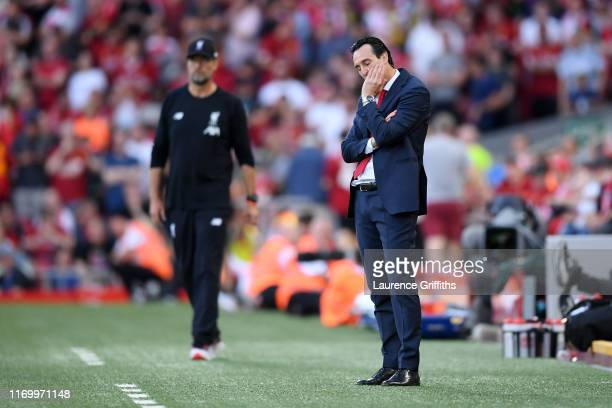 Unai Emery, Manager of Arsenal looks dejected in the final minutes of the Premier League match between Liverpool FC and Arsenal FC at Anfield on...