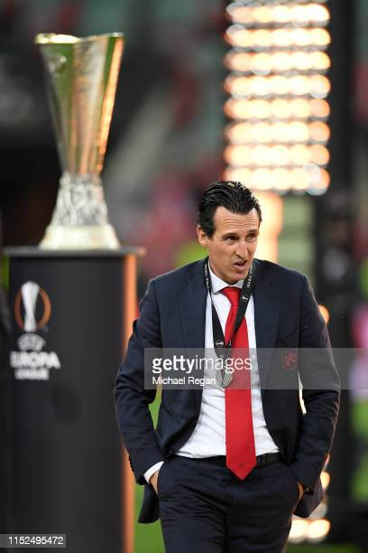 Unai Emery, Manager of Arsenal walks past the trophy dejected after the UEFA Europa League Final between Chelsea and Arsenal at Baku Olimpiya...