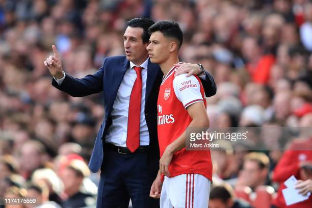 Unai Emery manager of Arsenal with Gabriel Martinelli during the Premier League match between Arsenal FC and AFC Bournemouth at Emirates Stadium on...