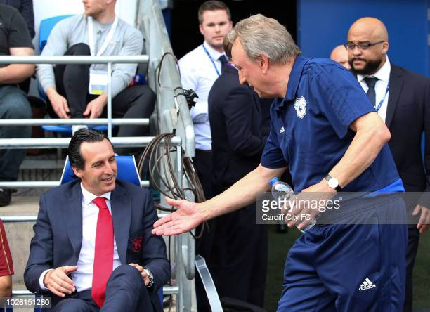 Unai Emery of Arsenal and Neil Warnock Manager of Cardiff City during the Premier League match between Cardiff City and Arsenal FC at Cardiff City...