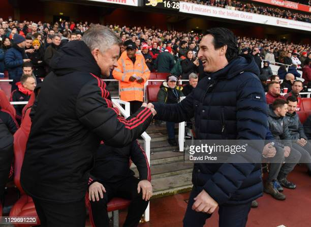 Unai Emery the Arsenal Head Coach shakes hands with Ole Gunnar Solskjaer the Man Utd Manager before the Premier League match between Arsenal FC and...