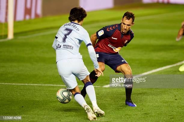 Unai Garcia and Joäo Felix are seen in action during the Spanish football of La Liga Santander match between CA Osasuna and Club Atletico Madrid at...