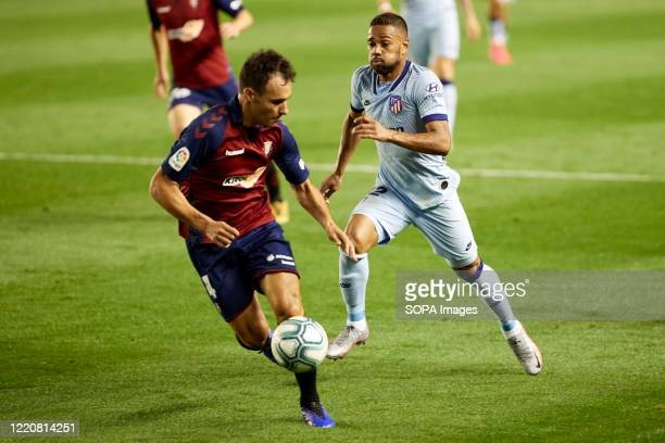 Unai Garcia and Renan Lodi are seen in action during the Spanish football of La Liga Santander match between CA Osasuna and Club Atletico Madrid at...