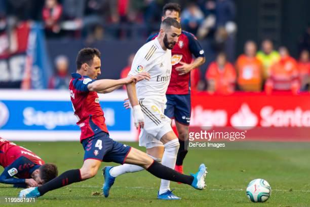 Unai Garcia of CA Osasuna and Karim Benzema of Real Madrid battle for the ball during the Liga match between CA Osasuna and Real Madrid CF at El...