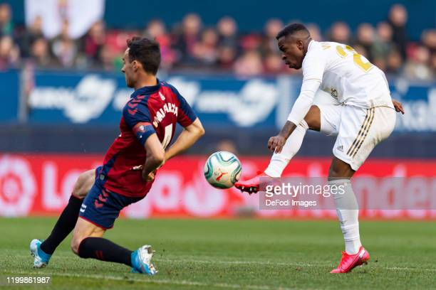 Unai Garcia of CA Osasuna and Vinicius Jr of Real Madrid battle for the ball during the Liga match between CA Osasuna and Real Madrid CF at El Sadar...