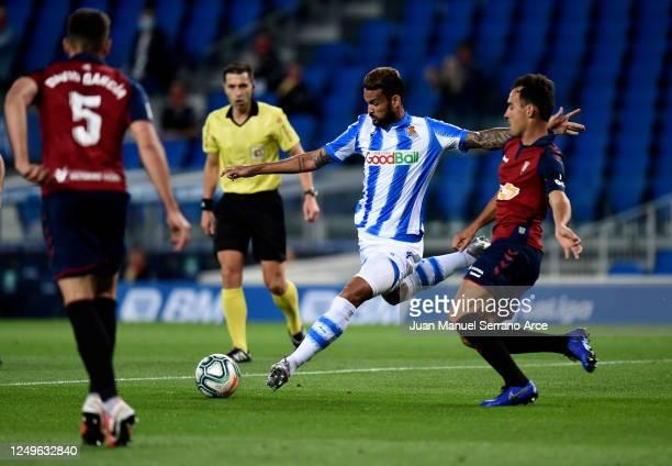 Unai Garcia of CA Osasuna beats Willian Jose of Real Sociedad during the Liga match between Real Sociedad and CA Osasuna at Estadio Anoeta on June 14...