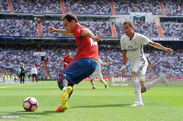 Unai Garcia of CA Osasuna clears the ball from Pepe of Real Madrid during the La Liga match between Real Madrid CF and CA Osasuna at Estadio Santiago...