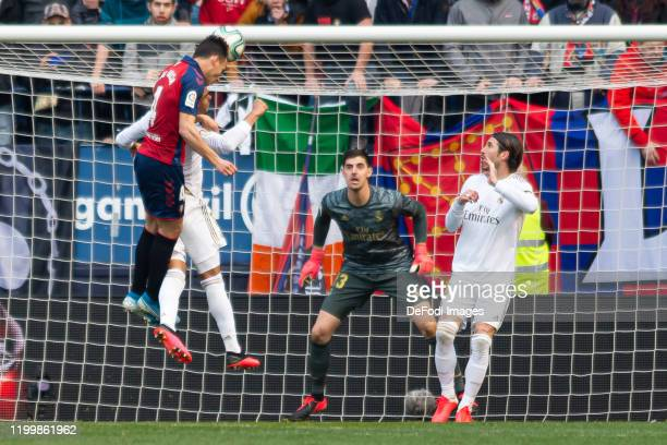 Unai Garcia of CA Osasuna goalkeeper Thibaut Courtois of Real Madrid and Sergio Ramos of Real Madrid battle for the ball during the Liga match...