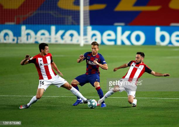 Unai Lopez and Mikel Vesga of Athletic Bilbao tackle Arthur of Barcelona during the Liga match between FC Barcelona and Athletic Club at Camp Nou on...